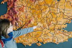 Woman pointing to the map of United Kingdom city of oxford Royalty Free Stock Photo
