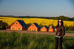Woman pointing to row of homes Stock Photos