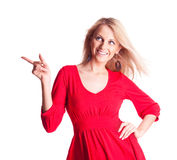 Woman pointing to the side Stock Photo