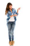 Woman pointing to the side Royalty Free Stock Photos
