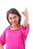 Woman pointing to the side against Stock Photography
