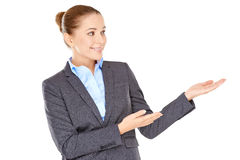 Woman pointing to the side with her hands Stock Image