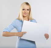 Woman pointing to signboard. Woman pointing to a blank board Royalty Free Stock Photography