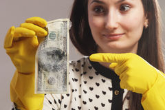 Free Woman Pointing To The Wet Money (money Laundering) Stock Photos - 70088303