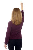 Woman pointing or touching a virtual screen Royalty Free Stock Photography