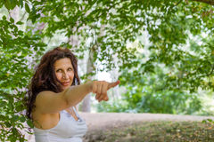 Woman pointing toward the viewer Royalty Free Stock Photo