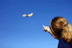 Woman pointing towards the blue sky Royalty Free Stock Photography