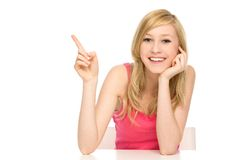 Woman pointing up Stock Photography