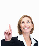Woman pointing up at copyspace on white backgroun Stock Images