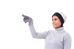 Woman pointing up, fall or winter outfit. White isolated background Royalty Free Stock Photos