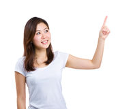 Woman pointing up with forefinger Stock Image