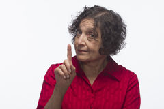 Woman pointing up, horizontal Stock Photo