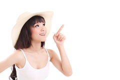 Woman pointing up, looking up, white isolated background Stock Photography