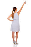 Woman pointing up. Rear view of woman pointing up on white background Royalty Free Stock Images