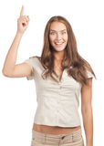 Woman pointing up and smiling Stock Images