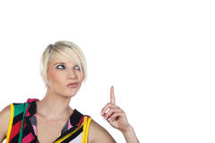 Woman pointing upwards Royalty Free Stock Image