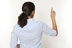 Woman pointing on virtual screen Royalty Free Stock Photo
