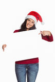 Woman pointing at white sign Stock Image