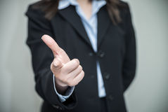 Woman pointing at you with one finger Royalty Free Stock Photo