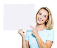 Woman points on the blank banner royalty free stock images