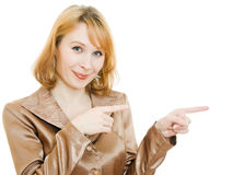 The woman points a finger in the direction Royalty Free Stock Image