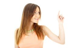 Woman points finger at something in her left. Stock Images
