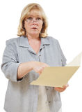 Woman points at foler. Mature woman points at the contents of a file folder stock images
