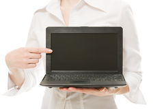 The woman points his finger on a laptop. Stock Photography