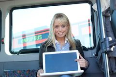 Woman points at the laptop-display inside a bus Stock Images