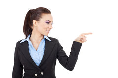 Woman points and looks at something Royalty Free Stock Photos