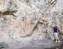 A Woman Points Out Pictographs at the Gila Cliff Dwellings Stock Photos