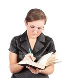 Woman in points reads the book. Stock Images