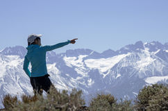 Woman Points To Distant Mountain Stock Photography