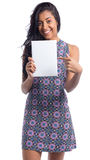 Woman points to white rectangle. Black brazilian girl wearing su Royalty Free Stock Photography