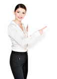 Woman points on the white blank banner Stock Photo