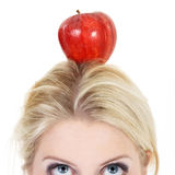 Woman poised with an apple Royalty Free Stock Photo