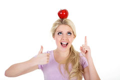 Woman poised with an apple Royalty Free Stock Photos