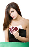 Woman poker cheater. White background royalty free stock image