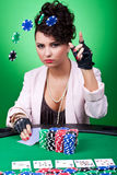 Woman with poker face making a bet. Sexy woman with poker face making a bet by throwing chips in the air Stock Images