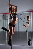 Woman and pole-dance Stock Image