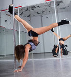 Woman and pole-dance Royalty Free Stock Photo
