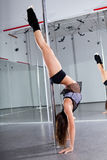 Woman and pole-dance Stock Photos