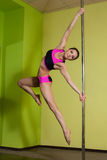Woman in the pole dance studio Stock Photos