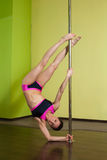 Woman in the  pole dance studio Royalty Free Stock Photography