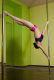 Woman in the  pole dance studio Stock Photo