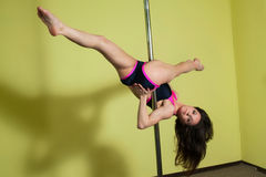 Woman in the pole dance studio Stock Photography