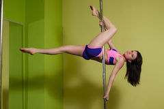 Woman in the pole dance studio Royalty Free Stock Photos