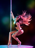 Woman pole dancer Royalty Free Stock Image