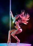 Woman pole dancer Royalty Free Stock Image