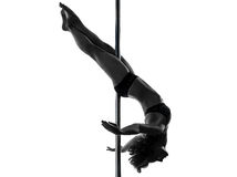 Woman pole dancer crossed knee pose silhouette Stock Photography